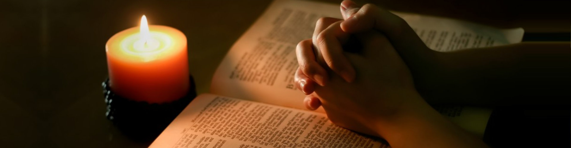 candle, bible, hands
